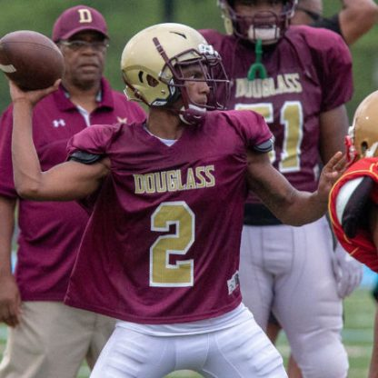 Douglass running back Cameron Munoz is converted to quarterback due to injury to the top two quarterbacks at Douglass.