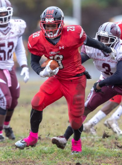 Temple Hills, MD, Saturday, October 27, 2018: Crossland running back Darius McBride (28) carries the ball during a PG County 3A/2A/1A football game at Crossland High School in Temple Hills, MD. (Michael R. Smith/The Prince George's Sentinel).